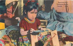 Linen of Little Seminole Girl Stringing Beads in Florida FL1