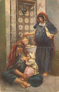 Tangel, Morocco. Street scene. Women with baby Old vintage postcard