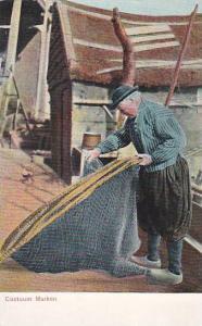 Dutch Man fixing fishing net, Costuum Marken, North Holland, Netherlands, 00-10s