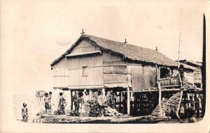 Port Moresby New Guinea Native House on the Sea Real Photo Postcard JH230702