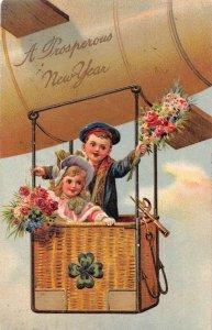 New Year Greetings Children in Zeppelin Airship PFB Postcard AA15244