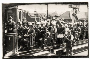 Postcard People on open-air tram; unknown location. ca. 1930