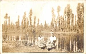 Mexico~Young Ladies posing in Wooden Canoes loaded w Flowers?~40s RPPC-Postcard