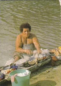 FIJI, 1950-1970's; Fijian Mom Washing Clothes By The River