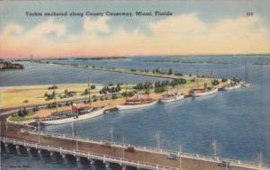 Florida Miami Yachts Anchored Along County Causeway