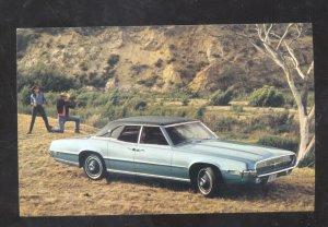 1969 FORD THUNDERBIRD LANDAU CAR DEALER ADVERTISING POSTCARD