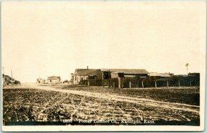 1917 KANORADO, Kansas RPPC Real Photo Postcard FOSTER LUMBER CO. Main Street Vie