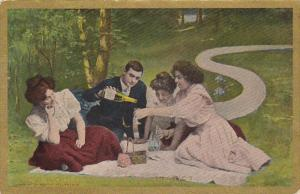 Romantic Couple Ladies Picnicing With Man Pouring Champagne 1910