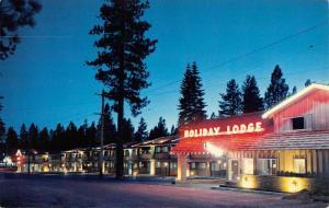Stateline California Holiday Lodge At Dusk Vintage Postcard K70773