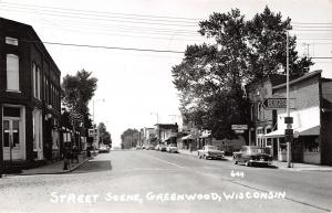 Greenwood Wisconsin~Main Street~Ford Tractor Dealer~Hotel~Cafe~1950s Cars~RPPC