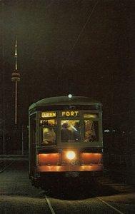 TORONTO , Ontario, Canada, 1960s ; Trolley car at night