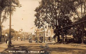 Lincoln ME Main Street Business District H. B. Stevens Store Horse & Wagons RPPC