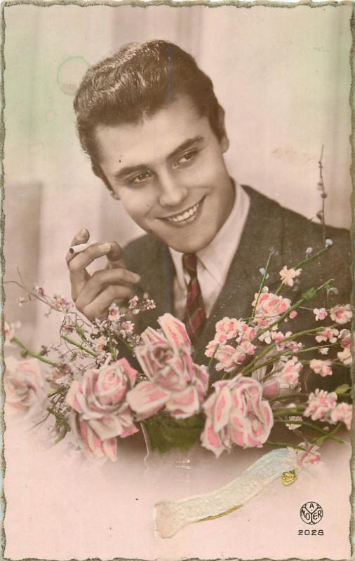 Handsome young man with cigarette & flowers