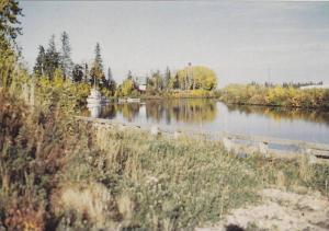 The peaceful beauty of fall colours adorn the Hay River, Canadian North,  Can...