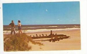 Couple Beside Shipwreck On Beach, Outer Banks, North Carolina, 1969