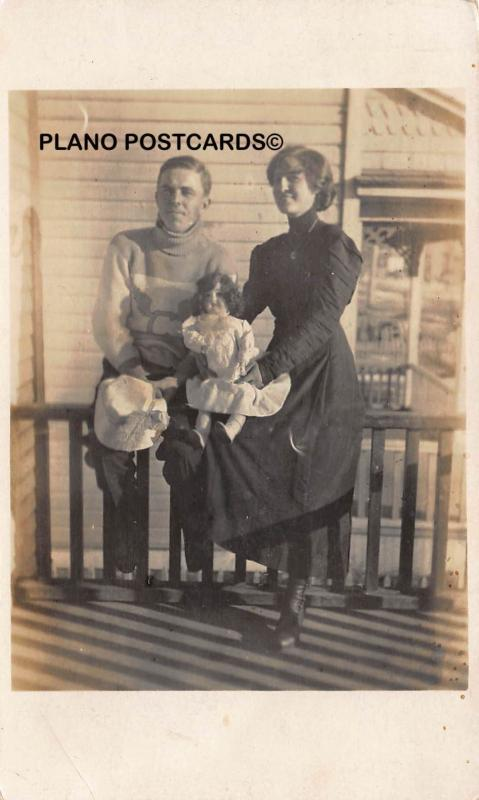EARLY 1900'S COUPLE WITH VINTAGE DOLL RPPC REAL PHOTO POSTCARD