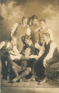 Postcard Young men elegant vintage clothing group photo
