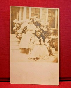 Circa 1908 Women Sitting on House Steps Hydrangea Bush Antique Picture Postcard