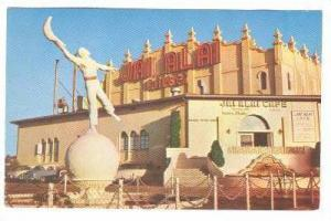 Partial view of the Fronton Palace, and the Jai-Alai Player Statue, Tijuana, ...