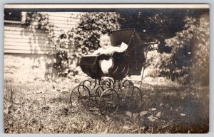 Real Photo Postcard~Laughing Baby Outside in Ornate Victorian Buggy~c1908 RPPC
