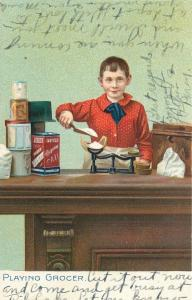 Playing Grocer~Boy Weighs Out Sugar~TUCK Little Men & Women Series~1907 Postcard