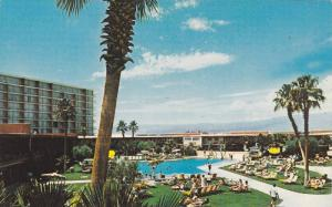 Bronze in The Nevada Sun at one of our two giant-size pools, Stardust Hotel a...