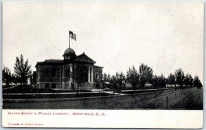 Redfield, South Dakota Postcard Irving Street & Public Library Building c1900s