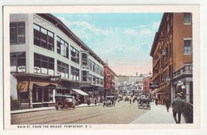 P1169 old unused postcard many old cars store signs main st. pawtucket R.I.