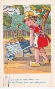 Young Dutch Girl With Wheelbarrow Tuinieren In Niet Ieders Vak