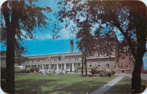 Waukesha Wisconsin~Moor Bath Hotel~Folk Sitting out on Lawn 1950 Postcard
