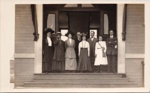 Group Portrait Family 8 People Hats Child Unknown Location RPPC Postcard E26