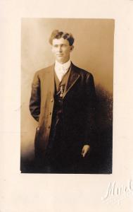 Bakersfield CA Photographer Murt~Man w/Locket on Chain~Tight Hair RPPC c1916