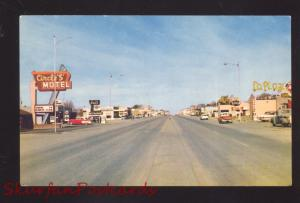 TUCUMCARI NEW MEXICO ROUTE 66 1950's CARS DOWNTOWN STREET SCENE POSTCARD