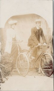 Man & Woman on Bicycles Studio Portrait 'Minnie & David Day' RPPC Postcard F99