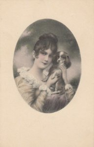 AS: Brunette woman holding English Toy Spaniel, 1900-10s