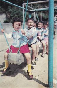 TAIPEI, Taiwan; Chinese Children at Play on swing, 40-60s