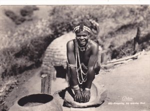 RP: Native girl preparing for mid-day Meal , South Africa , PU-1956