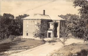Columbus Junction Iowa~Community Building~Stone Wall in Yard~1940s RPPC-Postcard
