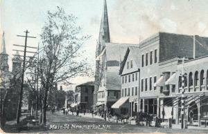 New Market, New Hampshire - A look at downtown on Main Street  - in 1910