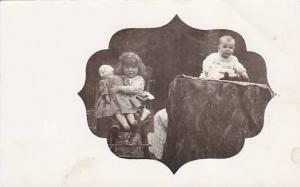 RP; Girl holding doll, baby sitting on tree stump, 10-20s