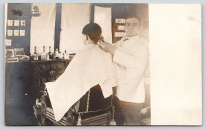 Real Photo Postcard~Vintage Barber Shop Interior~Boy Gets Hair Cut~c1905 RPPC