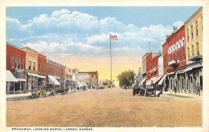 Larned Kansas~Broadway Looking North~Dewey Store~EAT Cafe~1916 Cars~Postcard