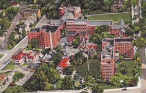 St. John's Riverside Hospital Group With The Longfellow High School In Backgr...