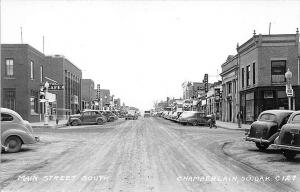 Chamberlain SD Street View Store Fronts Old Cars RPPC Postcard