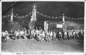JAPAN Military procession dark electric lights crowd people background