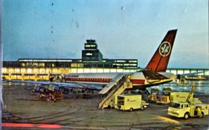 MONTREAL INTERNATIONAL AIRPORT- view of Air Canada DC 8 in the foreground, 1960s