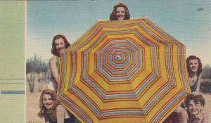 Five beach beauties poking out from behind large striped umbrella, 30-40s