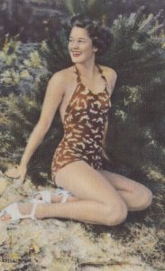 Pin-up girl wearing red & white spotted bathing suit , 30-40s