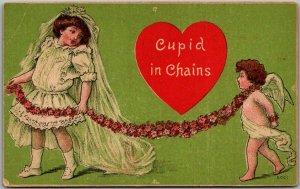 Vintage VALENTINE'S DAY Postcard CUPID IN CHAINS Girl in Wedding Dress #5001