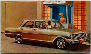 1963 CHEVY II 300 4-Door Sedan Chevrolet Advertising Postcard Bank Window Scene